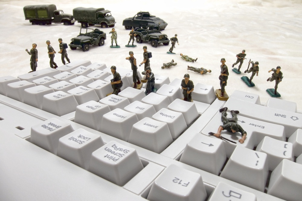Toy soliders fighting on a keyboard